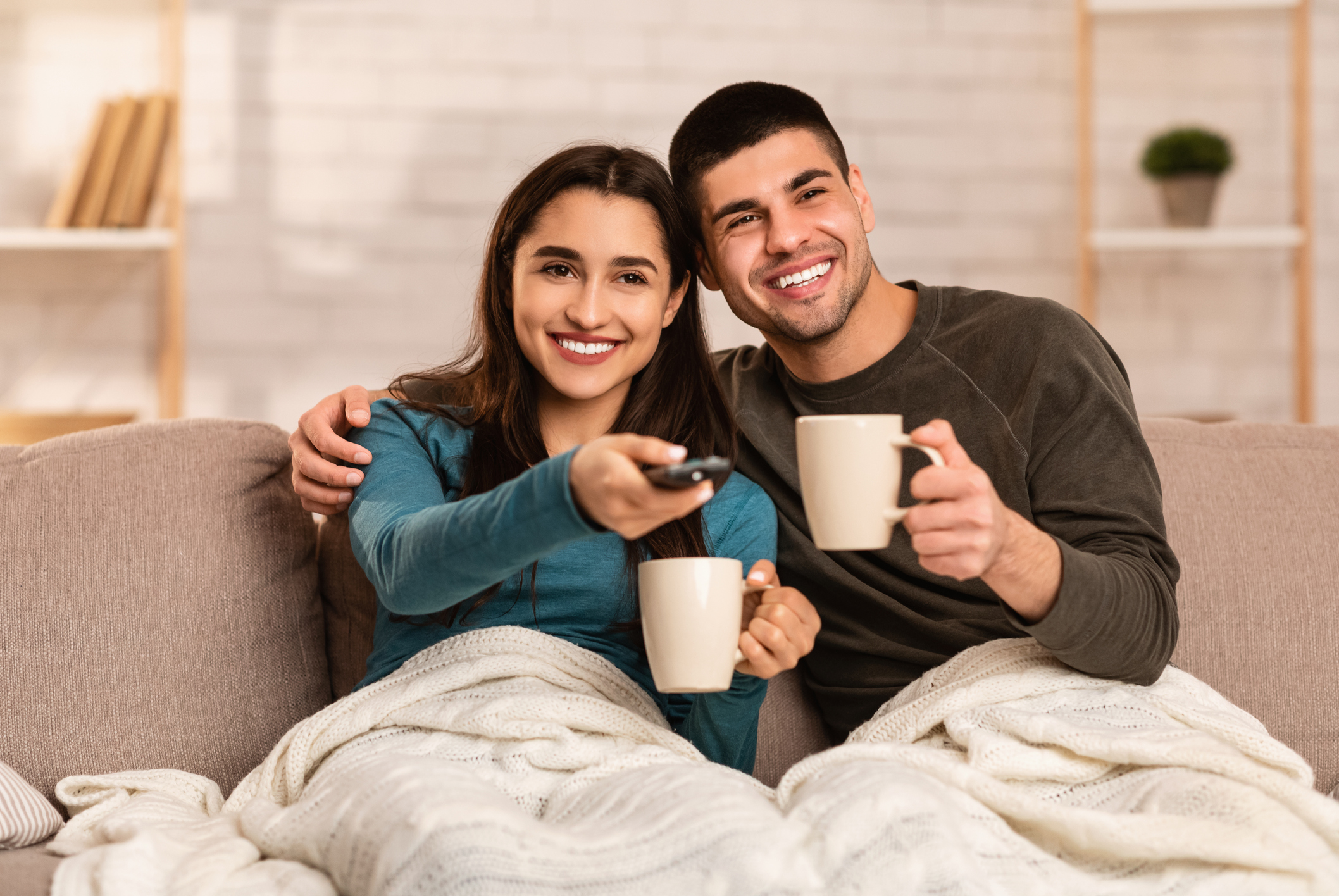 Couple sitting on couch and watching TV
